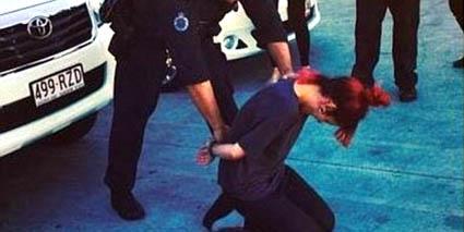Lily Allen in handcuffs